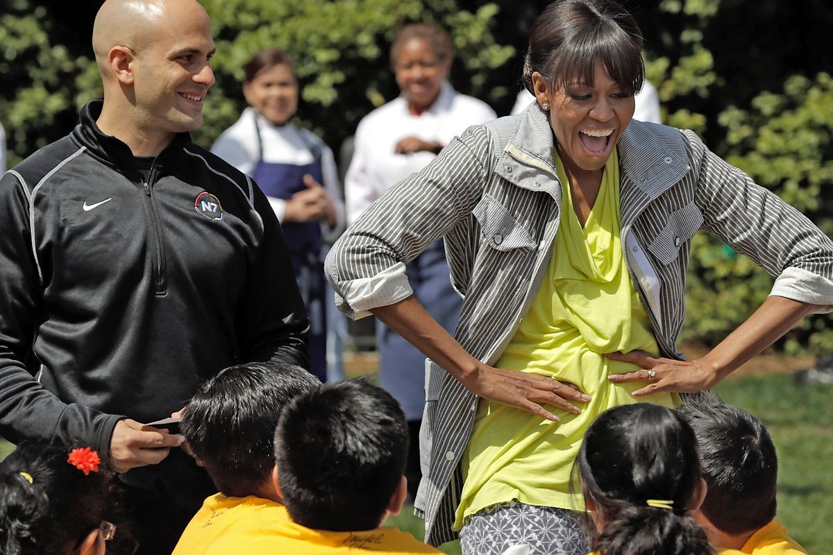 Sam Kass and Michelle Obama together in 2013.