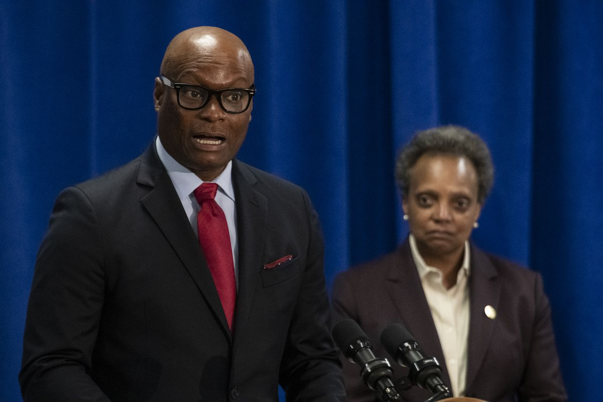 Former Dallas Police Chief David Brown, left, speaks to reporters after Mayor Lori Lightfoot, right, nominated him to be Chicago's next police superintendent Thursday, April 2, 2020.