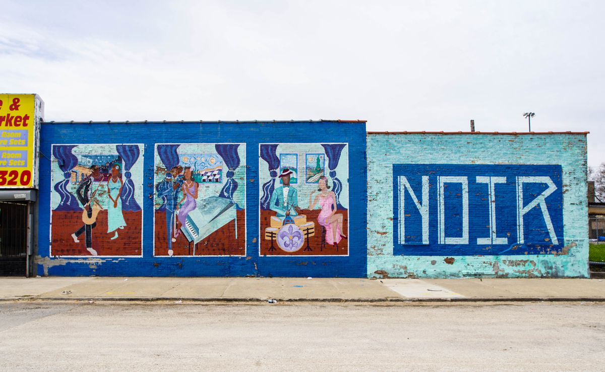 """A mural completed in 2012 at 47th Street and Calumet Avenue by Charles Jean-Pierre, titled """"Bronzeville Noir,"""" looks to the blues and jazz traditions of the South Side."""