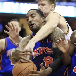 Cleveland Cavaliers' Luke Harangody, top, and New York Knicks' J.R. Smith battle for a rebound in the second quarter in an NBA basketball game on Friday, April 20, 2012, in Cleveland.