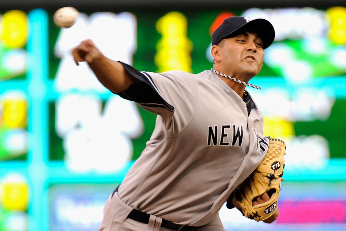 MINNEAPOLIS, MN - AUGUST 20: Luis Ayala #38 of the New York Yankees delivers a pitch against the Minnesota Twins in the second inning on August 20, 2011 at Target Field in Minneapolis, Minnesota. (Photo by Hannah Foslien/Getty Images)