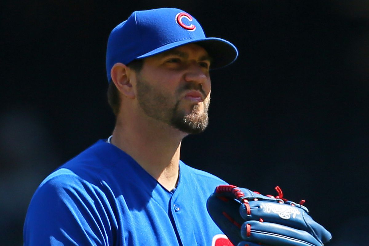 Today's winning pitcher Jason Hammel reacts to being told he still has to play for the Cubs.