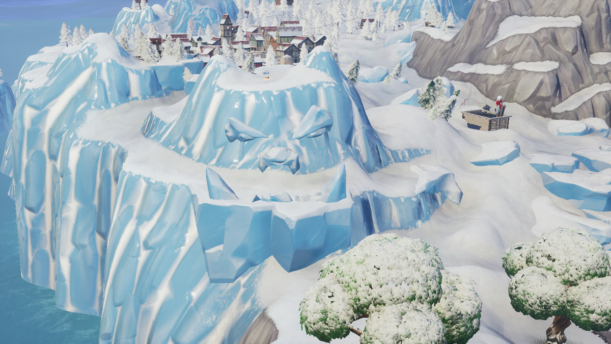 the snow face epic games via polygon - visit a giant face in the desert jungle and snow fortnite challenge