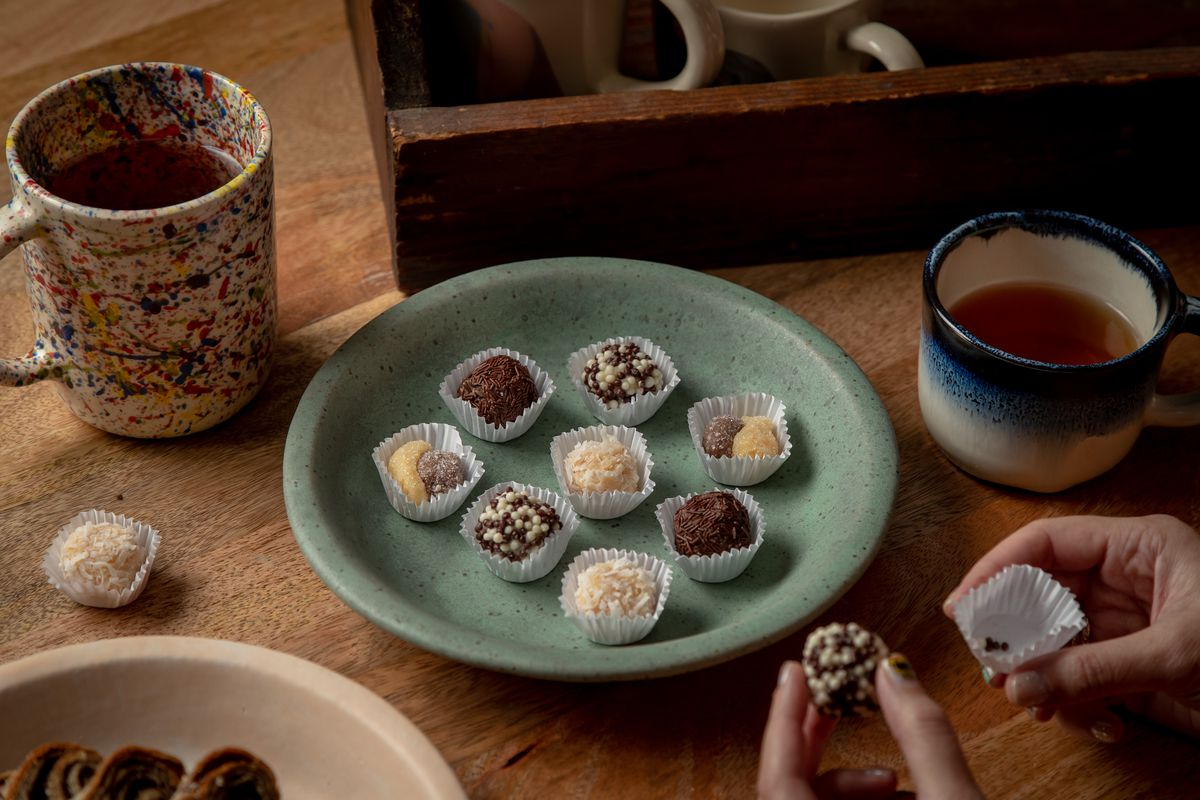 A green plate topped with Brazilian truffles from Washington Square bakery Brigadeiro
