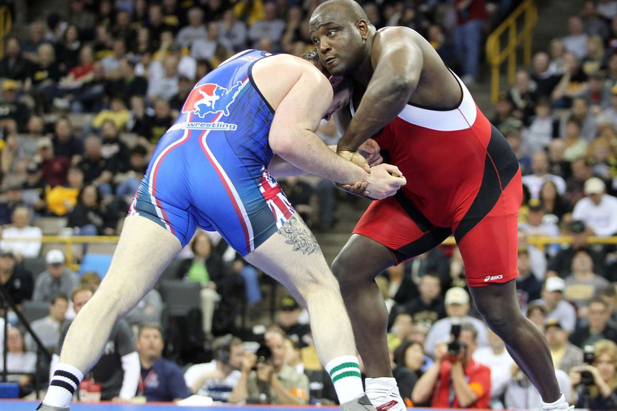 April 21, 2012; Iowa City, IA, USA; Dremiel Byers (red) wrestles with Steve Andrus (blue) in the 120kg greco roman match at Carver Hawkeye Arena.   Mandatory Credit: Reese Strickland-US PRESSWIRE