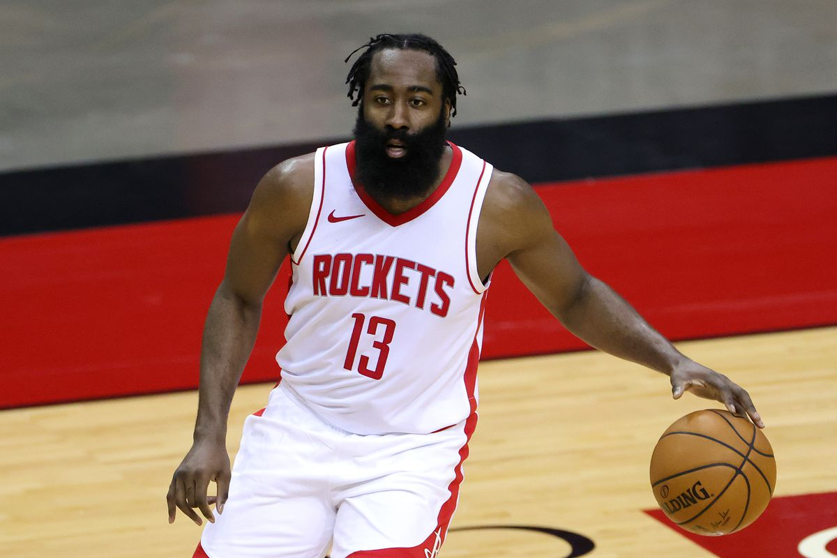 James Harden #13 of the Houston Rockets controls the ball during the first half of a game against the San Antonio Spurs at the Toyota Center on December 17, 2020 in Houston, Texas.