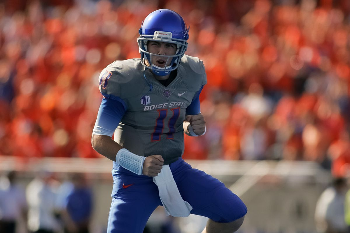 BOISE, ID - OCTOBER 22:  Kellen Moore #11 of the Boise State Broncos celebrates after a touchdown against the Air Force Falcons at Bronco Stadium on October 22, 2011 in Boise, Idaho.  (Photo by Otto Kitsinger III/Getty Images)
