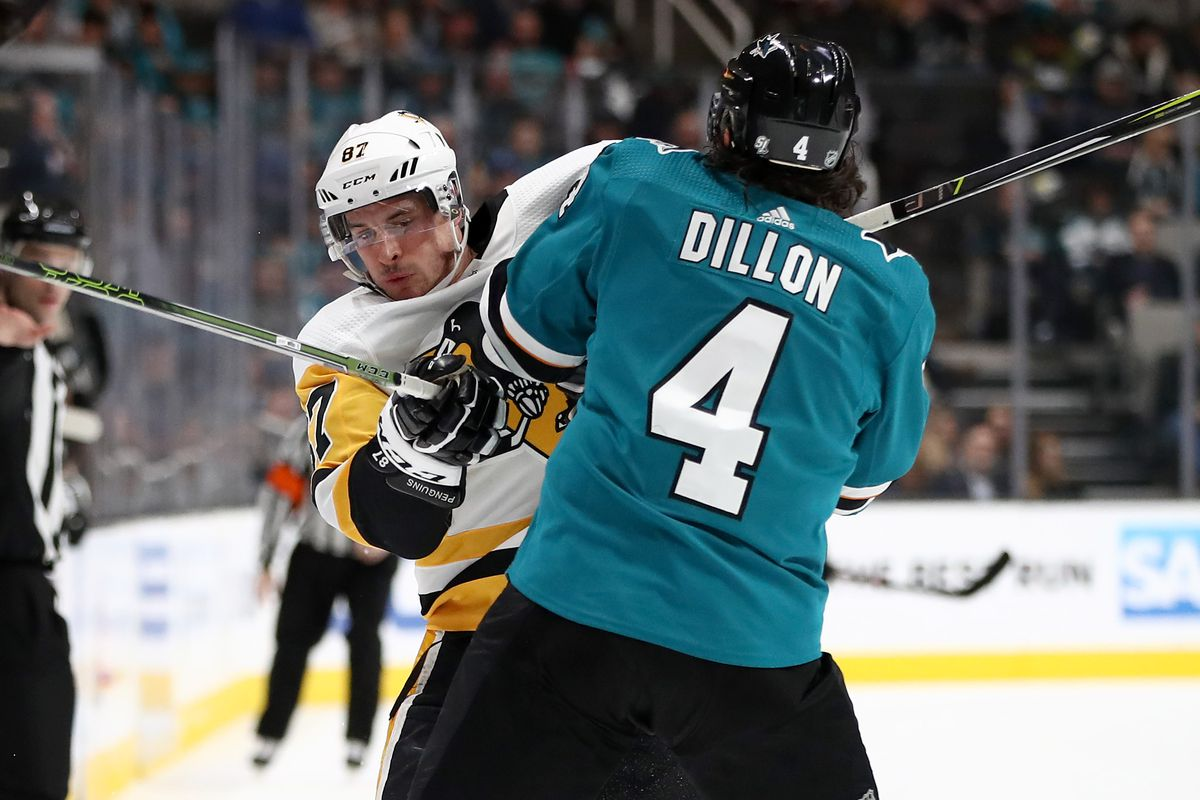 SAN JOSE, CALIFORNIA - JANUARY 15: Brenden Dillon #4 of the San Jose Sharks collides with Sidney Crosby #87 of the Pittsburgh Penguins at SAP Center on January 15, 2019 in San Jose, California.