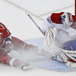 Carolina Hurricanes' Eric Staal (12) has a shot deflected by Montreal Canadiens goalie Peter Budaj (30), of Slovakia, during the third period of an NHL hockey game in Raleigh, N.C., Thursday, April 5, 2012. Carolina won 2-1 in a shootout.