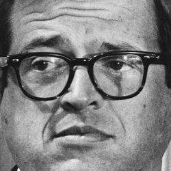 In this March 1, 1974 photo, former White House attorney Charles Colson talks to reporters after he was charged in the Watergate cover-up in Washington.