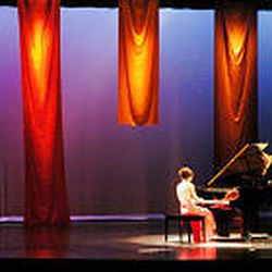 Lindsay Thacker, first runner-up, plays the piano during the talent competition of the Miss Murray pageant. Although interest in pageants may be declining, they provide women a powerful venue.