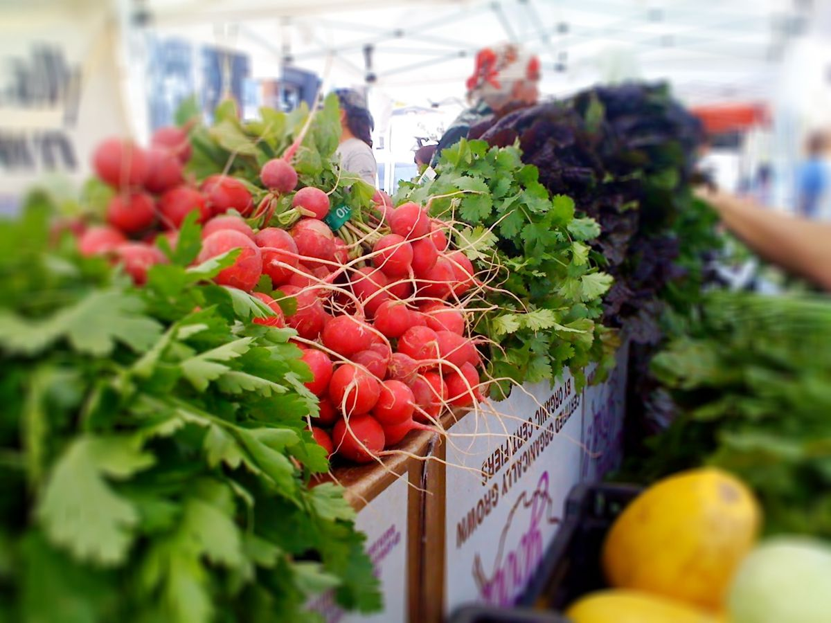 A bunch of radishes, herbs, and other fresh produce for sale at the Mar Vista Farmers Market in Los Angeles.
