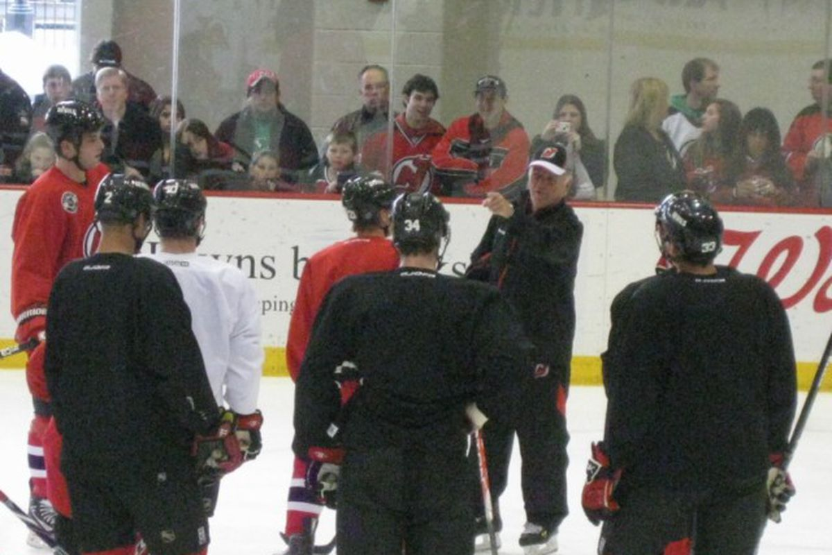 Jacques Lemaire instructs the Devils at today's optional practice at the AmeriHealth Pavilion in front of a crowd of Devils season ticket holders. (Picture by John Fischer)