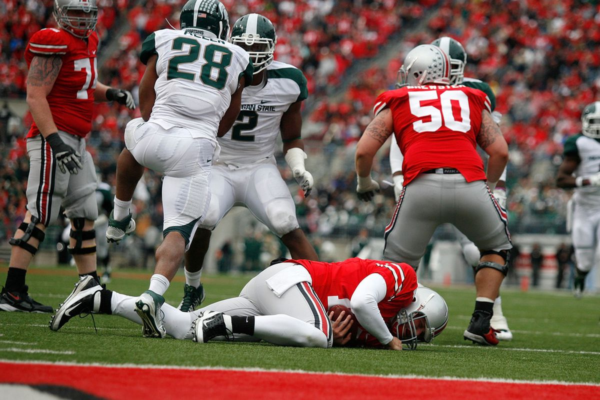 Michigan State spent a lot of time last year putting opposing quarterbacks on the turf.  (Photo by Kirk Irwin/Getty Images)