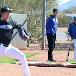 Yu Darvish and Nippon-Ham Fighters head coach Hideki Kuriyama watch as a Fighter's pitcher throws a bullpen on the backfields of Salt River Fields in Scottsdale, AZ.   John Antonoff/For the Sun-Times