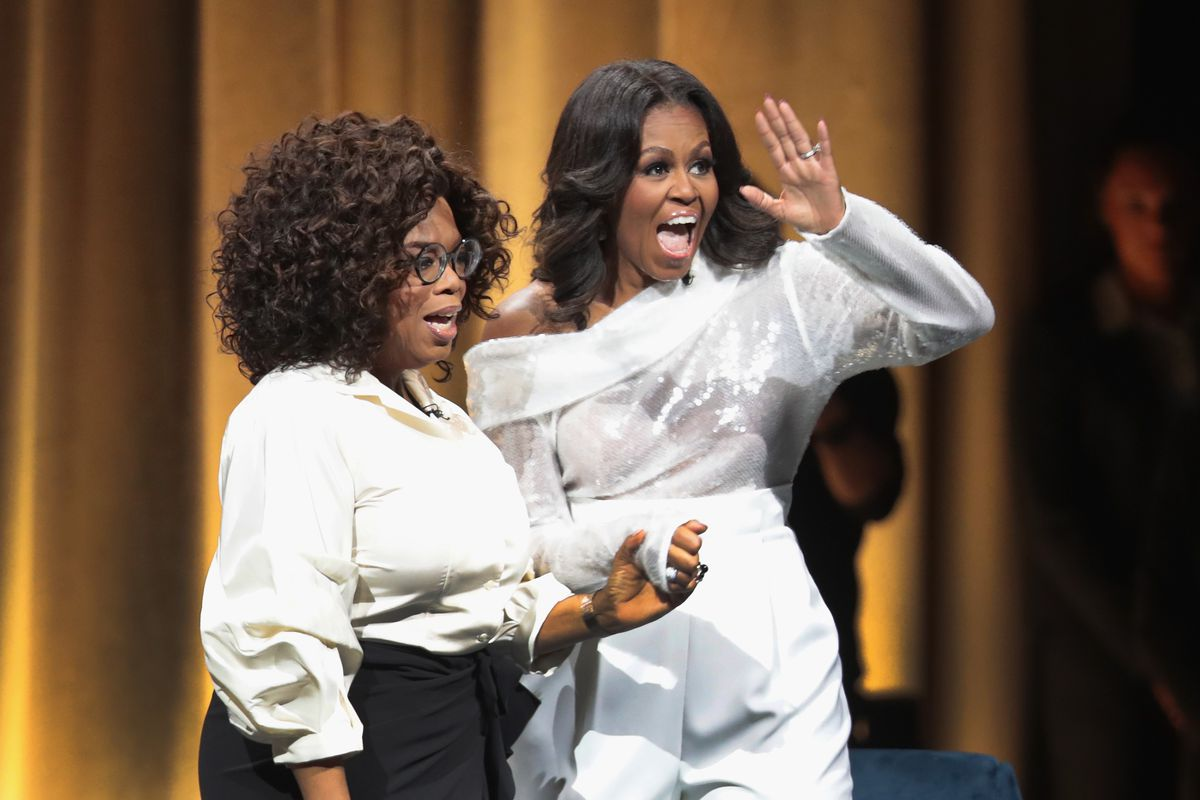 Oprah Winfrey introduces former first lady Michelle Obama as she kicks off her 'Becoming' arena book tour in 2018 in Chicago.
