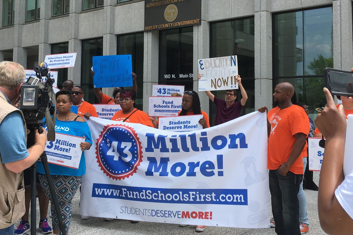 Education advocates rally outside of the building where Shelby County's Board of Commissioners meet to discuss funding for Shelby County Schools.