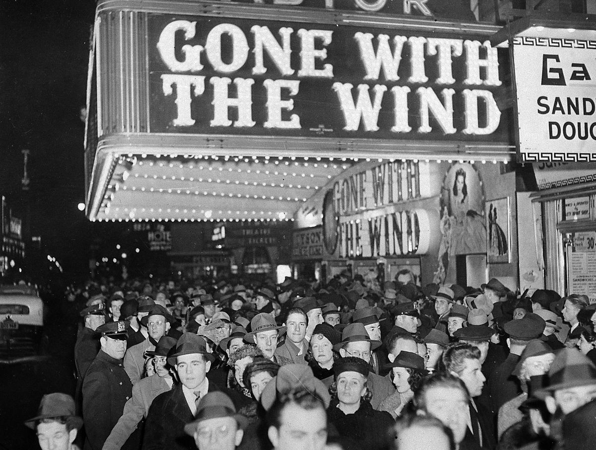 """A crowd gathers outside the Astor Theater on Broadway during the premiere of """"Gone With the Wind"""" in New York in 1939."""