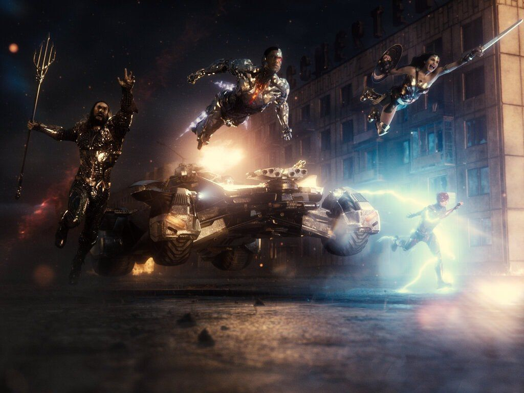 Aquaman, Cyborg, the Batmobile, Wonder Woman, and the Flash charge into battle in Zack Snyder's Justice League