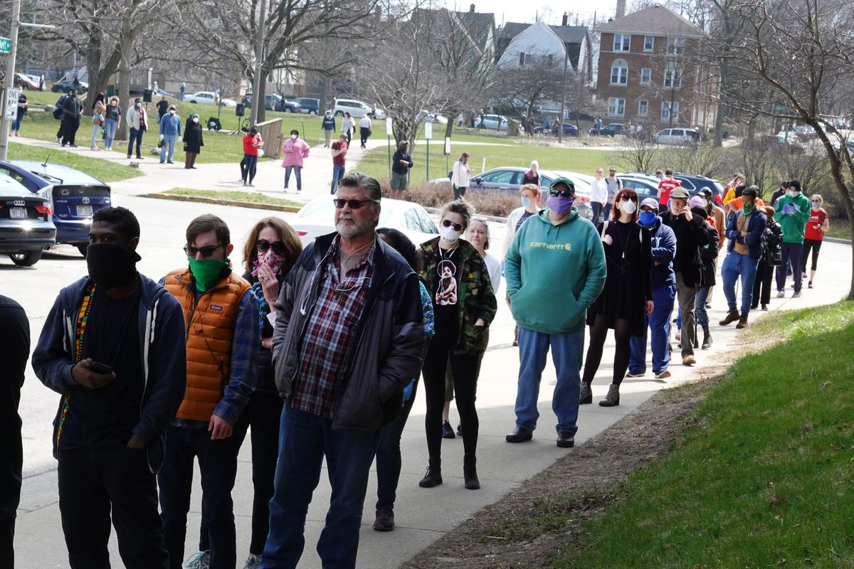 Voters wait in line at a polling place at Riverside University High School on April 07, 2020 in Milwaukee, Wisconsin.