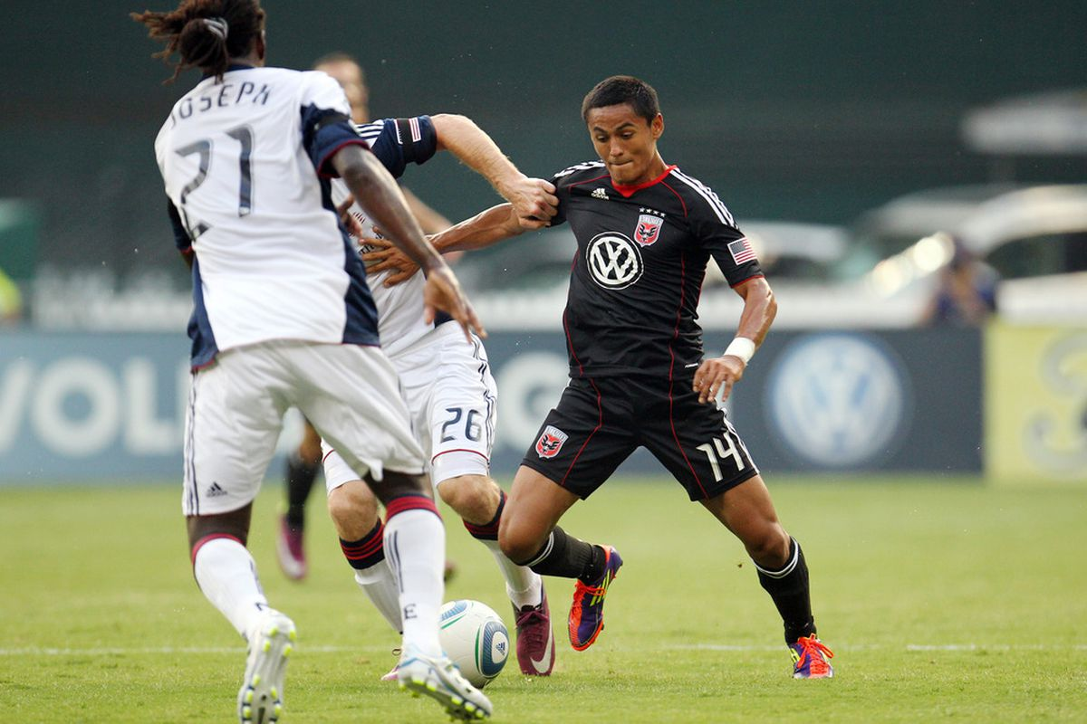 WASHINGTON, DC - JULY 20: Andy Najar #14 of D.C. United controls the ball against Stephen McCarthy #26 of the New England Revolution at RFK Stadium on July 20, 2011 in Washington, DC. (Photo by Ned Dishman/Getty Images)