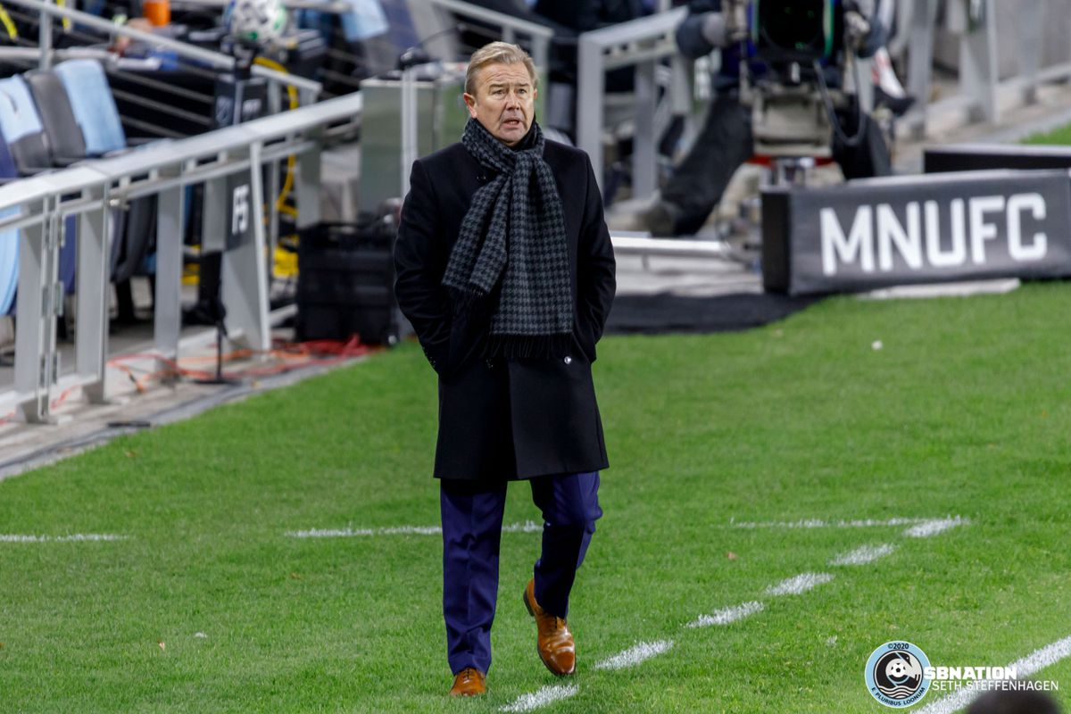 October 18, 2020 - Saint Paul, Minnesota, United States - Minnesota United head coach Adrian Heath watches a replay on the jumbotron during the match against Houston Dynamo at Allianz Field.