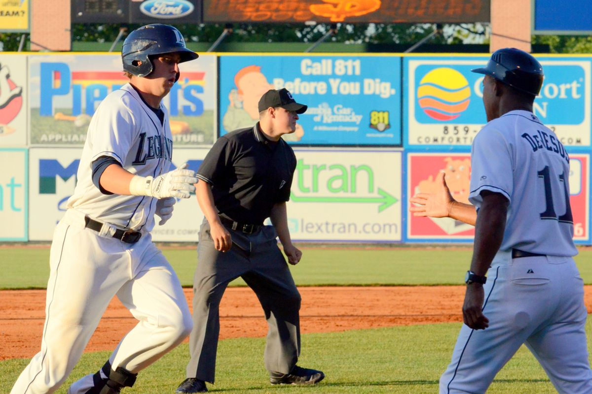 Duffy gets congrats from manager Ivan DeJesus after a mammoth shot to LF