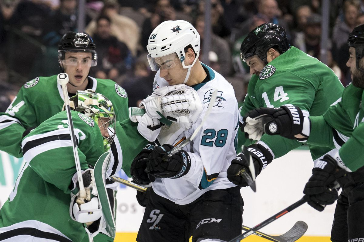 Dec 7, 2018; Dallas, TX, USA; Dallas Stars goaltender Ben Bishop (30) and left wing Jamie Benn (14) defend against San Jose Sharks right wing Timo Meier (28) during the third period at the American Airlines Center.