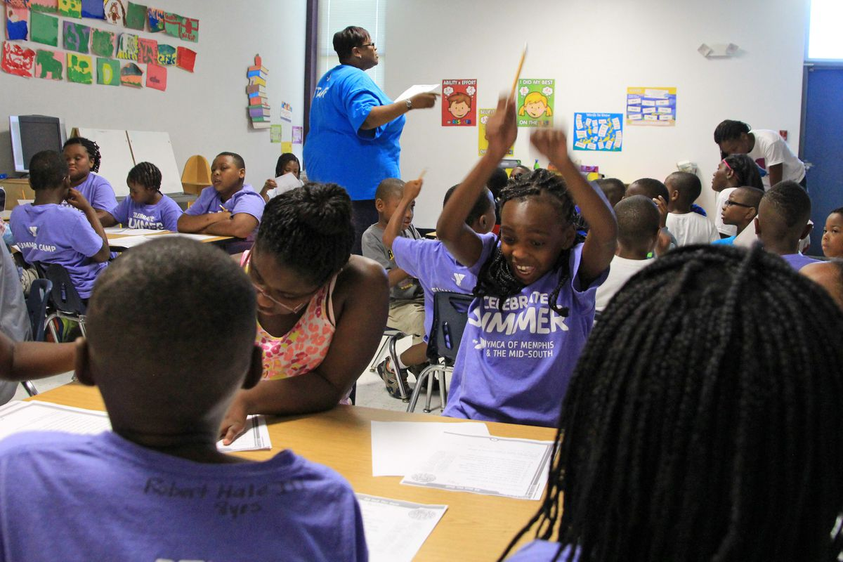 Kayla Terrell, 8, reacts to getting a question correct on her reading worksheet.
