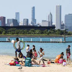 People enjoy the weather and spend the day at 31st Street Beach on the South Side, Wednesday afternoon, July 24, 2019