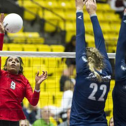 Bountiful outside hitter Seyvion Waggoner spikes the ball against two Corner Canyon blockers during the UHSAA class 4A volleyball title match in Orem on Saturday, Nov. 5, 2016. Bountiful swept Corner Canyon 3-0 for the championship crown.