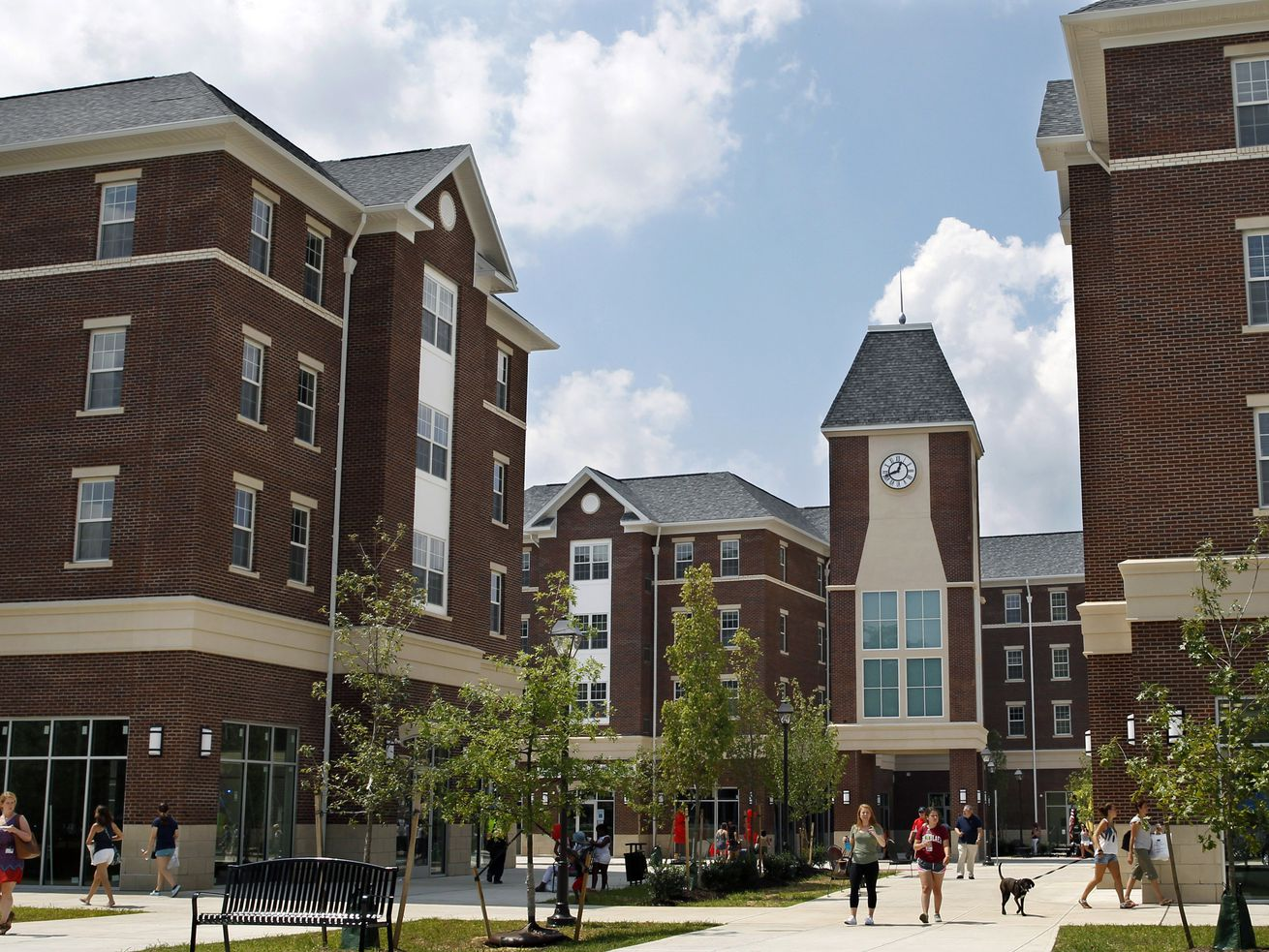 The courtyard of the Campus Town at The College of New Jersey, a mixed-use college housing development consisting of numerous brick-covered buildings.