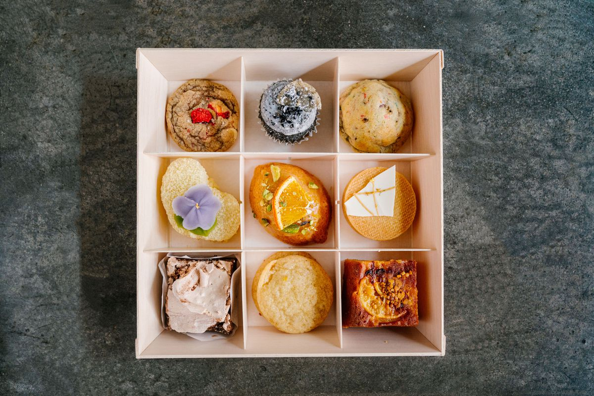 A box divided into nine squares, each holding a beautiful pastry.