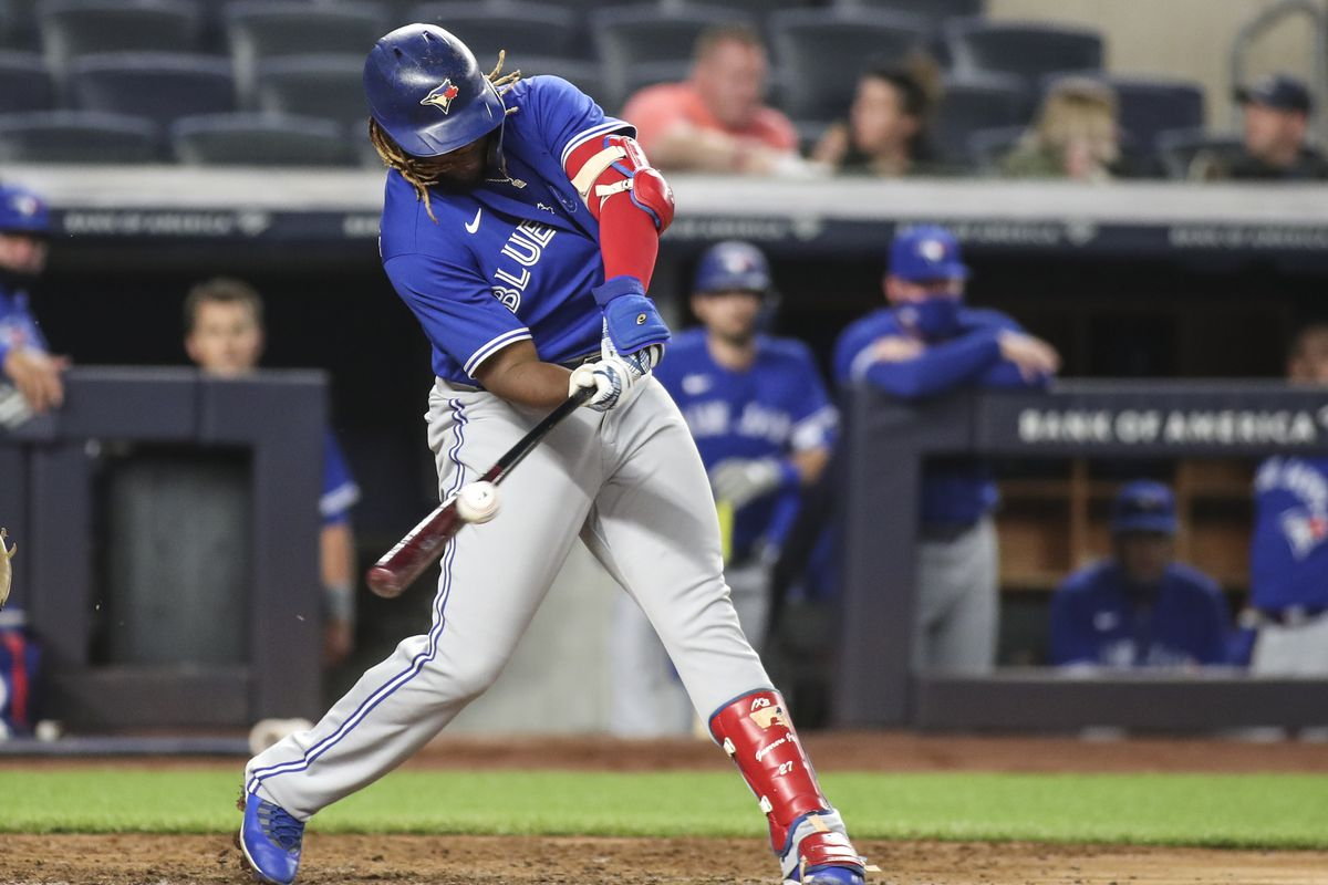 Toronto Blue Jays first baseman Vladimir Guerrero Jr. (27) hits a single in the fifth inning against the New York Yankees at Yankee Stadium.