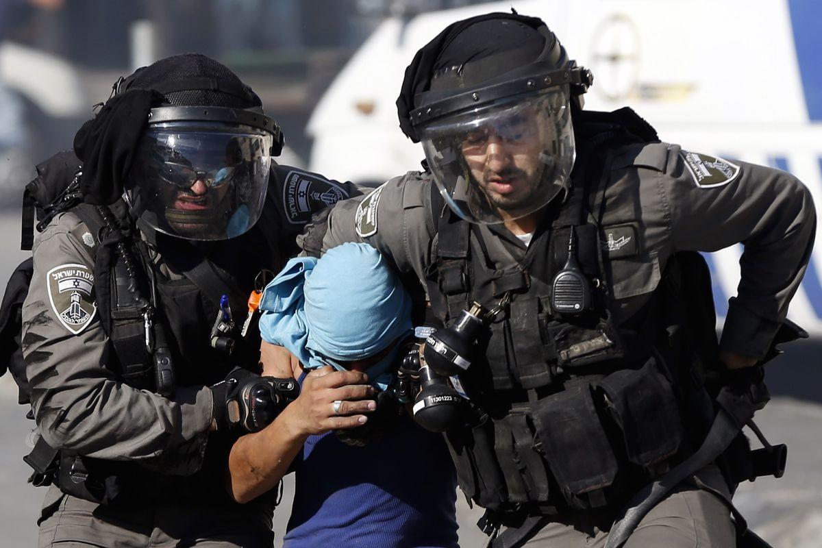 Israeli police arrest a Palestinian during September 18 clashes in Shuafat, an east Jerusalem refugee camp.