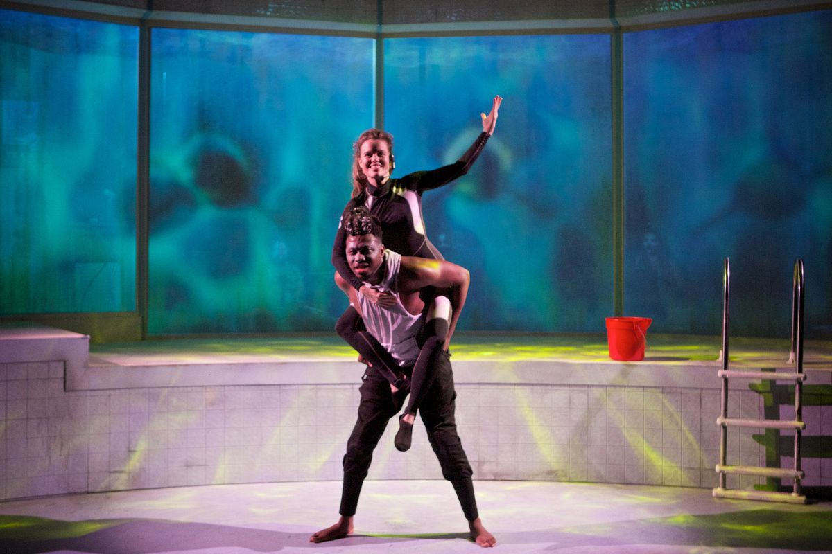 """Gregory Geffrard stars as Tilikum and Sigrid Sutter portrays his trainer Dawn in a scene from Sideshow Theatre's production of """"Tiikum."""" 