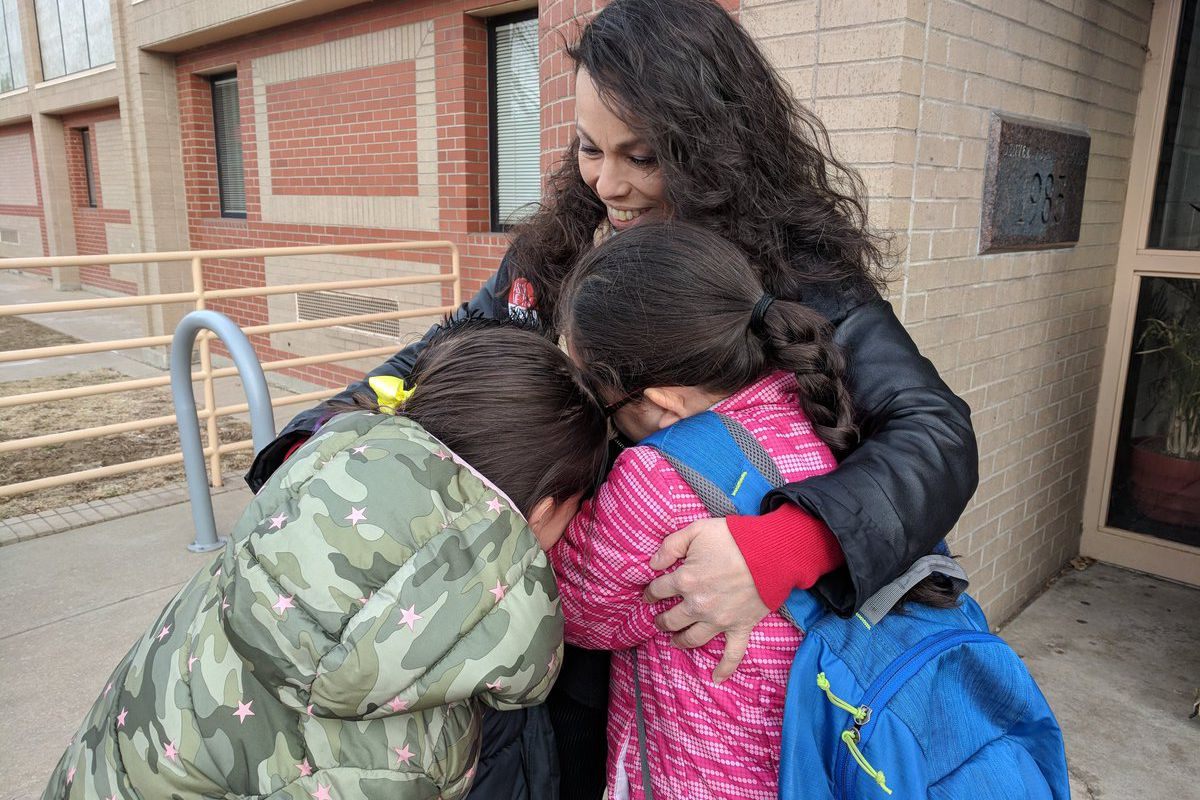 Lupe Lopez-Montoya greets students at Columbian Elementary School on Thursday after Denver's three-day teacher strike.
