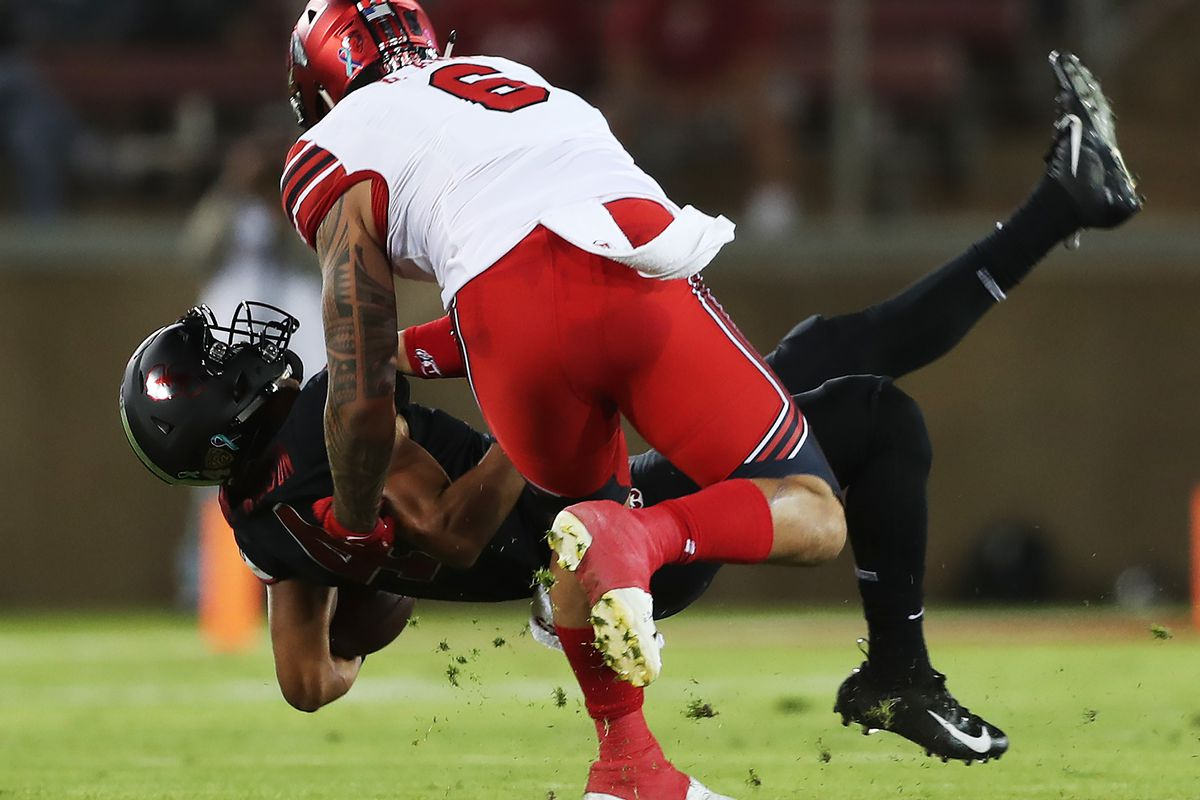 Utah Utes defensive end Bradlee Anae (6) hammers Stanford Cardinal wide receiver Michael Wilson (4) to the ground as Utah and Stanford play a football game in Palo Alto, California, on Saturday, Oct. 6, 2018.