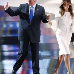 Donald Trump leaves with his wife, Melania, after her speech during the National Republican Convention in Cleveland on Monday, July 18, 2016.