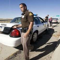 Utah Highway Patrol trooper Mike Singleton walks to get a breathalyzer as he conducts a roadside sobriety test Wednesday, Oct. 17, 2012, on a female driver on Bangerter Highway near 1300 South. The woman was arrested for investigation of drunken driving.