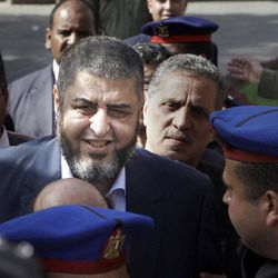 In this April 5, 2012, the Muslim Brotherhood candidate for the presidency Khairat el-Shater leaves the Higher Presidential Elections Commission after submitting his candidacy papers, in Cairo, Egypt. The presidential election scheduled in May will mark the beginning of a handover of power by the ruling military to an elected civilian, following last year's popular uprising that overthrew Hosni Mubarak. (AP Photo/Amr Nabil)