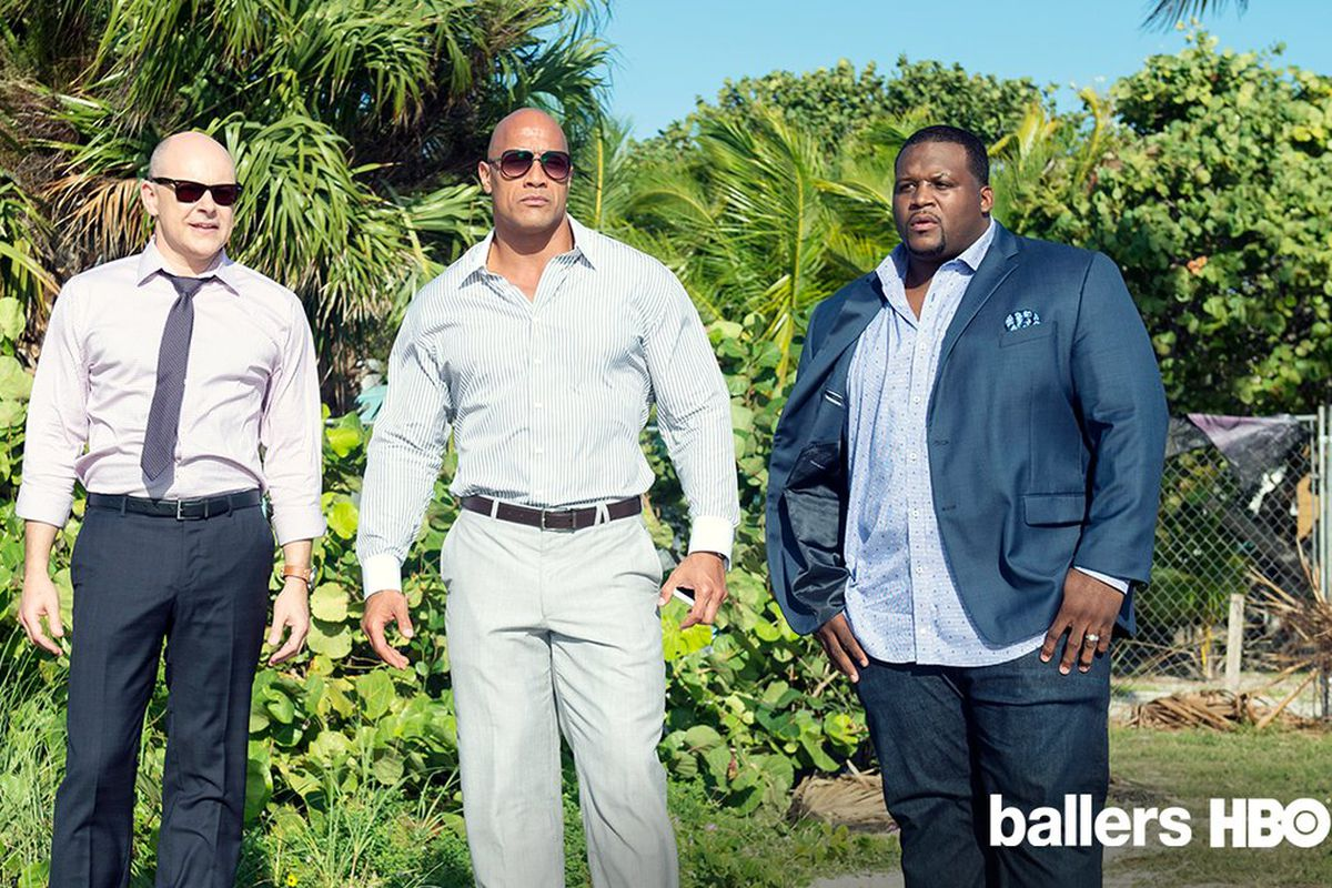 """Spencer Strasmore (Dwayne Johnson) and Joe Krutel (Rob Corddry) down in the Keys with """"Spice"""" Adams"""