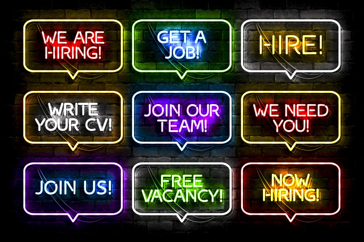 """Nine neon signs arranged in a grid, each in a speech bubble, that say things like """"now hiring!"""" """"we need you!"""" and """"join our team!"""""""