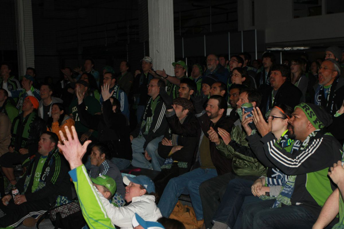 Viewing Party Crowd Reacts To A Call