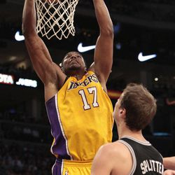 Los Angeles Lakers center Andrew Bynum (17) dunks as San Antonio Spurs' Tiago Splitter (22) looks on during the first half of their NBA basketball game, Tuesday, April 17, 2012, in Los Angeles.
