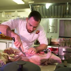 Matt Harubin of B&B Ristorante works on the whole pig he used in the Culinary Clash finals.