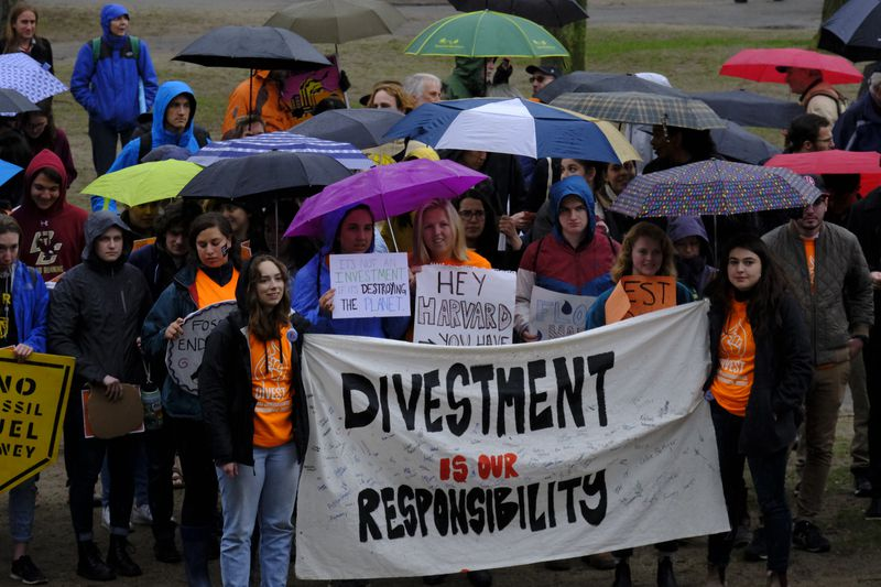 Students and activists at Harvard University call for divesting the school's holdings in fossil fuels at a rally on April 26, 2019.