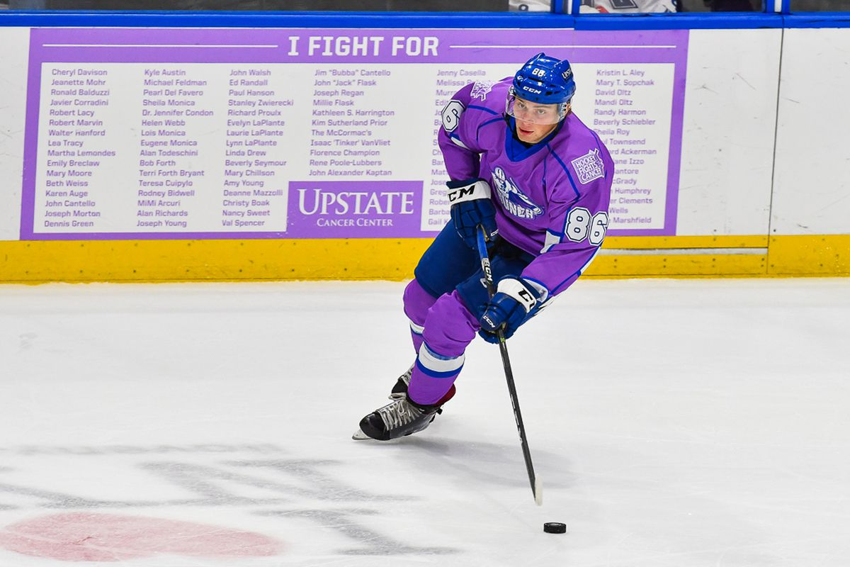 50e9be707 Syracuse Crunch Mitch Hults (86) wearing the special Hockey Fights Cancer  jersey against the Laval Rocket in American Hockey League (AHL) action at  the War ...