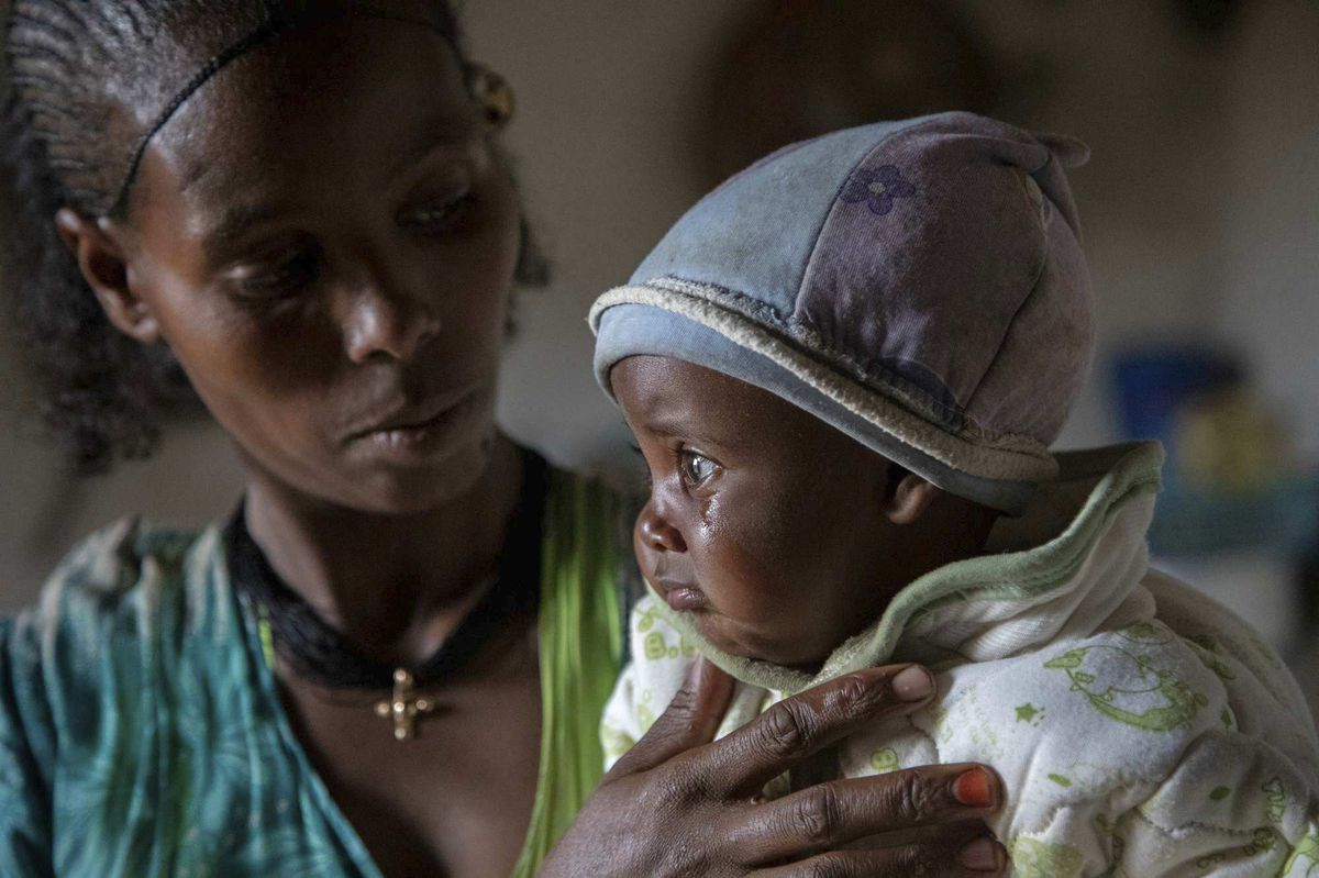 Mother Ababa, 25, comforts her baby Wegahta, 6 months old, who was identified as severely acutely malnourished, in Gijet in the Tigray region of northern Ethiopia.