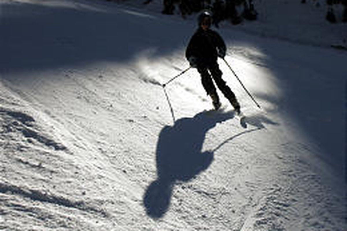 A skier cruises on the opening day at Snowbird Resort in Little Cottonwood Canyon on Thursday.